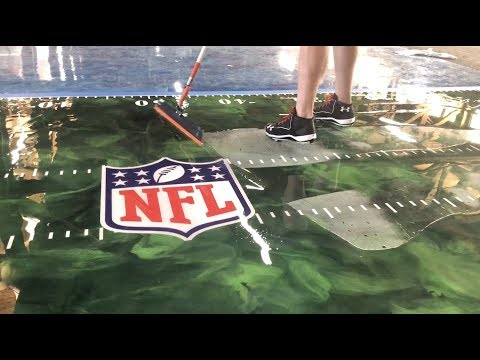 Super Bowl XLIV Metallic Epoxy Floor With Decals! - Concrete Floor Pros